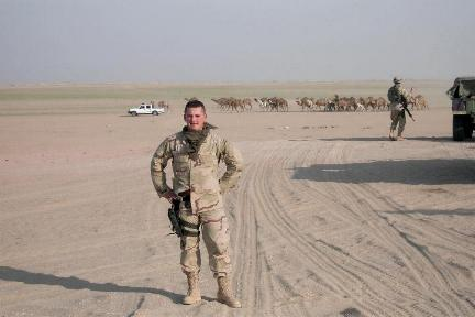 Photograph of an American soldier in the desert of Iraq, taken by an American soldier of C Co, 1/252 Army Reserve Battalion . Logo for the M203.com presentation entitled Sand.