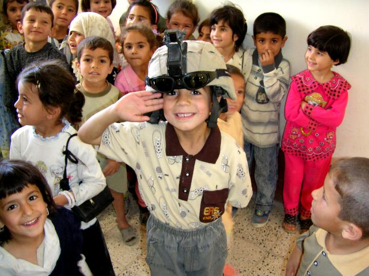 Iraqi school children photograph taken during a visit to a school, taken by an American soldier in Charlie Company, 1/252 Army Reserve Battalion.