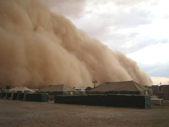 Photograph of a sand storm in Al Asad, Iraq as it is about to engulf tents, taken by an unidentified American soldier.